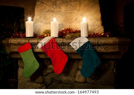 Christmas stocking on fireplace background. - stock photo