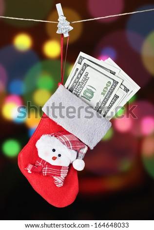 Christmas Stocking Stuffed with Money - stock photo