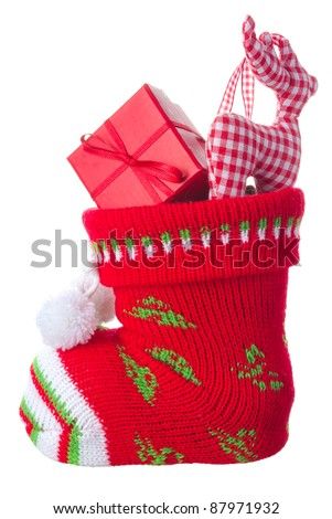Christmas stocking stuffed with present box and a deer, isolated on white background - stock photo