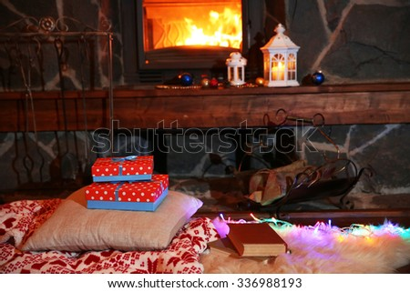 Christmas stockings hanging over the fireplace at midnight on Christmas Eve - stock photo