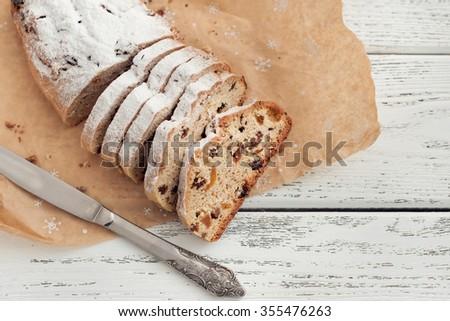Christmas stollen on wooden background - stock photo