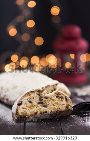 Christmas stollen with festive lights - stock photo