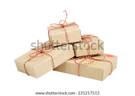 Christmas style rustic brown paper gift tied up with strings. Isolated white background. Stacking parcels box with kraft paper. - stock photo