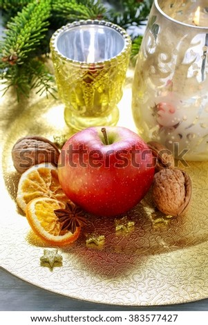 Christmas table decoration with apple and dried fruits - stock photo