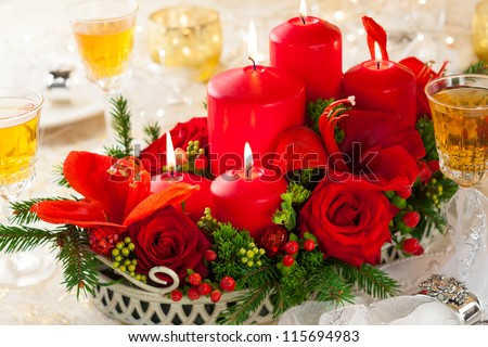 Christmas table decoration with flowers and candles - stock photo
