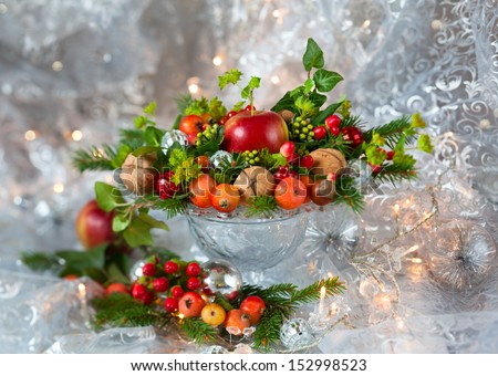 Christmas table decoration with fruit, nuts, fir branches - stock photo