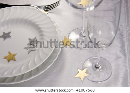 Christmas table - Festive table setting for Christmas with little stars - stock photo
