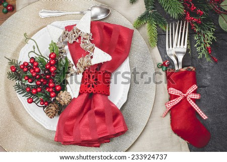 Christmas table setting.Christmas And New Year holiday place setting. Done with vintage retro filter. - stock photo