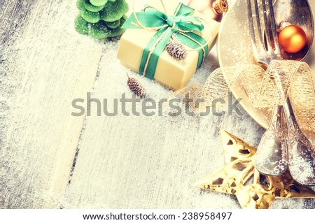 Christmas table setting in gold and green tone - stock photo