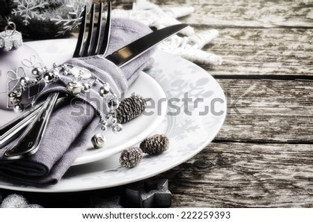 Christmas table setting in silver tone  - stock photo