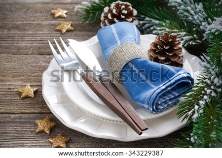 Christmas table setting on a wooden background, close-up, horizontal - stock photo