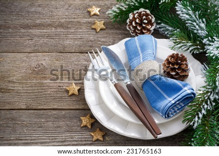 Christmas table setting on a wooden background, horizontal, top view, close-up - stock photo