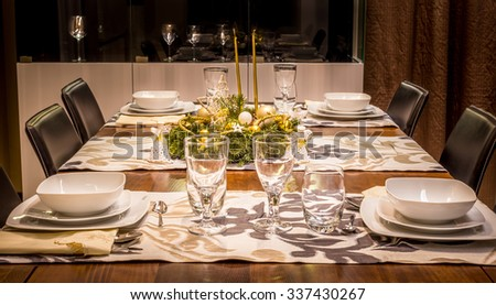 Christmas table setting prepared for festive dinner - stock photo