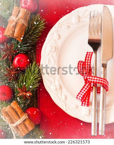 Christmas table setting with Christmas ornament with hoarfrost frame. - stock photo