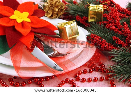 Christmas table setting with festive decorations close up - stock photo