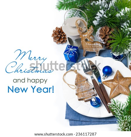 Christmas table setting with wooden decorations and spruce branches, top view, isolated on white - stock photo