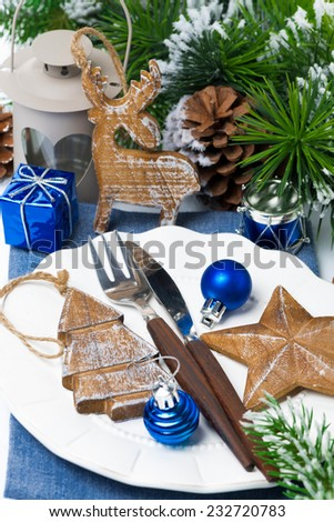 Christmas table setting with wooden decorations, close-up, vertical - stock photo