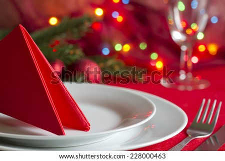 Christmas table with cutlery and tableware abstract background - stock photo