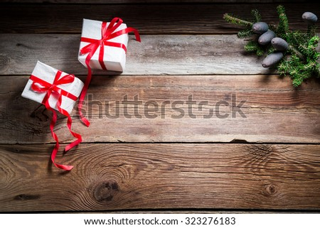 Christmas table with gifts and copy space as background - stock photo