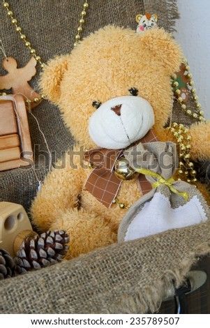 Christmas teddy bear in an old case with decorative items for a festive season - stock photo
