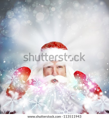 Christmas theme: Santa Claus blowing snowflakes from his arms. Designed Poster - stock photo