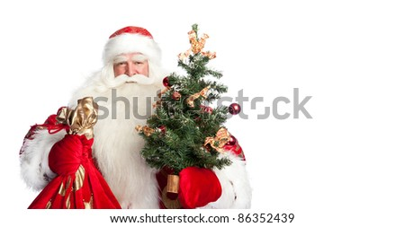 Christmas theme: Santa Claus holding christmas tree? staff and his bag full of gifts over white background - stock photo