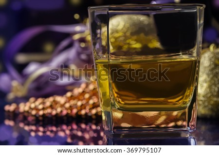 Christmas time glass of whiskey decoration and gifts  - stock photo