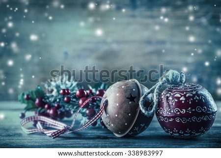 Christmas Time.  Jingle Bells pine branches Christmas decoration in the snow atmosphere. Vintage decoration - stock photo