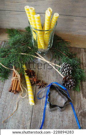 Christmas time picture with candle and fir tree. Selective focus - stock photo