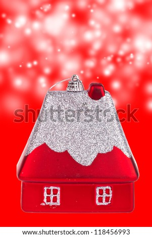 Christmas toy in the form of a small house - stock photo
