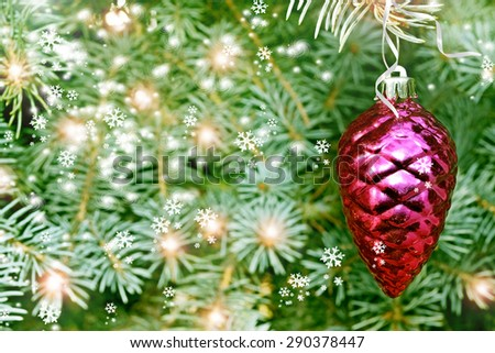 Christmas toy pine cone on the tree - stock photo
