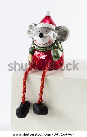 Christmas toy Santa Claus - a mouse on a white background - stock photo