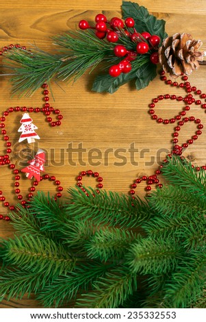 Christmas toys and place for text and pine tree on wooden background - stock photo