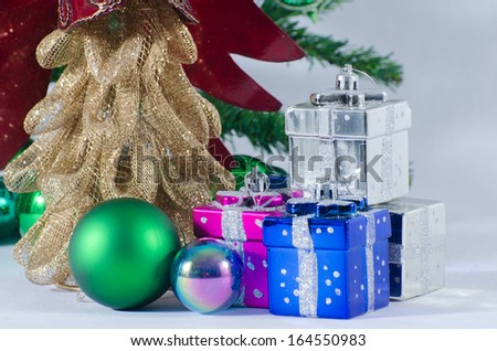 Christmas toys on a fir-tree branch isolated on white background - stock photo