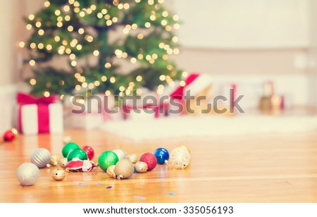 Christmas tree and Christmas ornaments on floor - stock photo