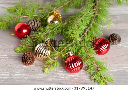 Christmas tree and decoration on a wooden background, horizontal - stock photo