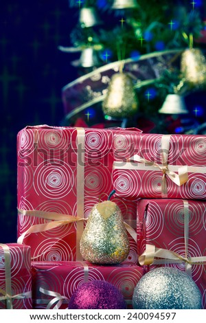 Christmas tree and gift boxes, blue light background  - stock photo