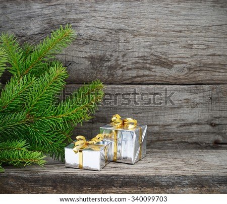 Christmas Tree and gift boxes on wooden background - stock photo