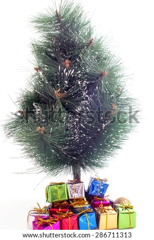 Christmas tree and gifts on a white background selective focus - stock photo