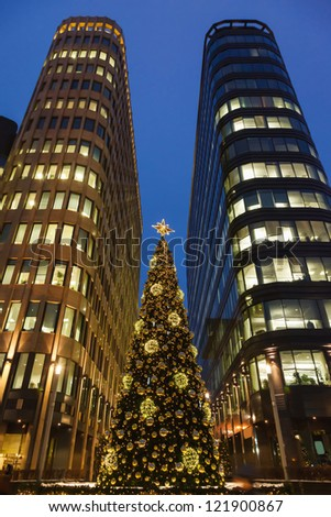 Christmas tree and skyscrapers of business center - stock photo
