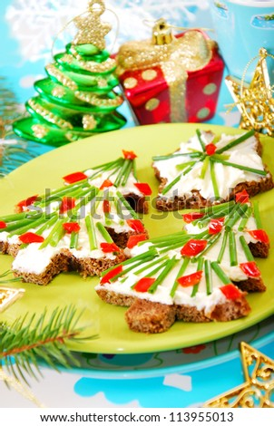 christmas tree and star shape sandwiches with dark bread,cheese and chive as breakfast for child - stock photo