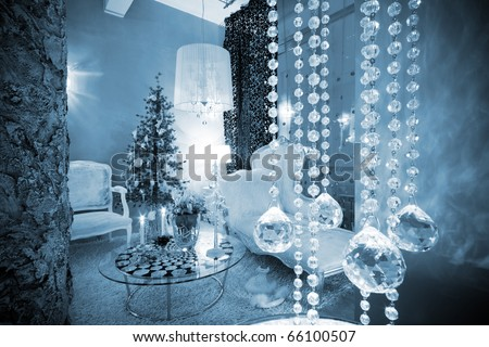 Christmas tree at the window in a modern apartment - stock photo