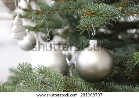 Christmas tree branch decorated with silver balls and white decor - stock photo
