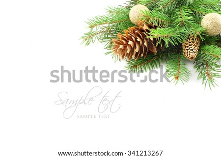 Christmas tree branch with decorations - stock photo