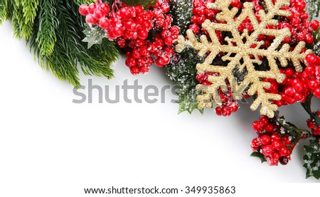 Christmas tree branch with red berries and golden snowflake on white background - stock photo