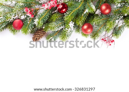 Christmas tree branch with snow and baubles. Isolated on white background with copy space - stock photo