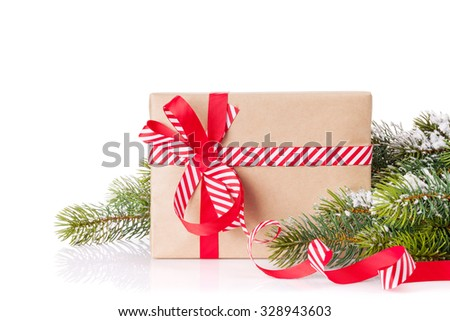 Christmas tree branch with snow and gift box. Isolated on white background - stock photo