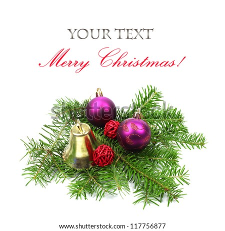 Christmas tree branches and decoration with bell and ball on white background - stock photo