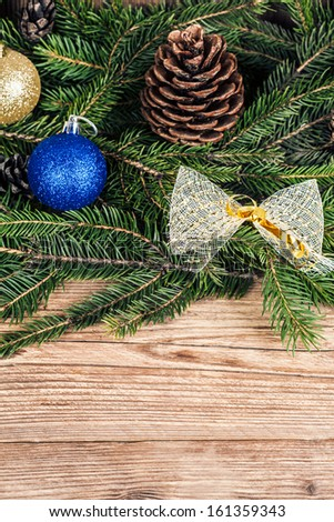 christmas tree branches with decoration - stock photo