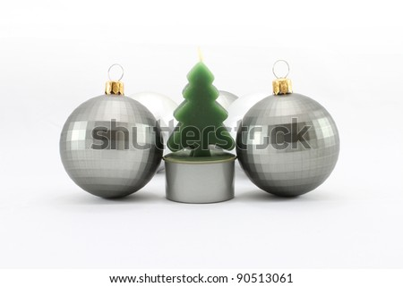Christmas Tree candle with silver christmas mirror balls - stock photo